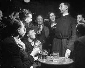 Priest drinking in a pub during a revival of the Church of England
